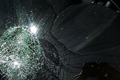 black car broken windshield evident for vandalism