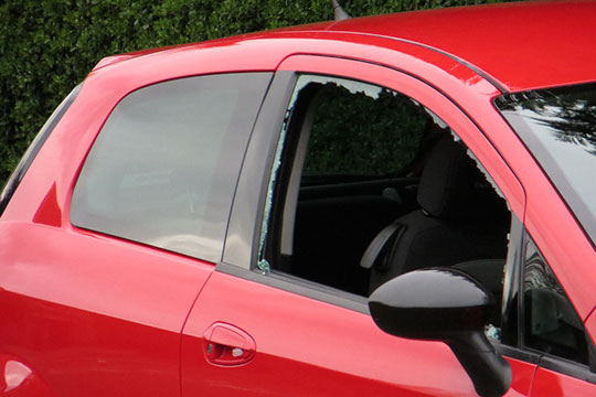 red hatch back car side passenger front door glass broken in Wizard Auto Glass