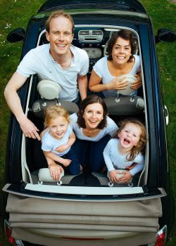 happy family in the convertible car